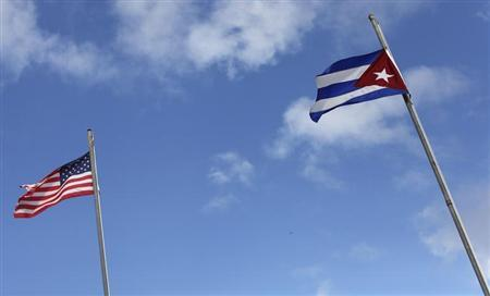 The flags of the United States and Cuba are seen flying in the Little Havana neighborhood of Miami, Florida January 26, 2012. REUTERS/Shannon Stapleton