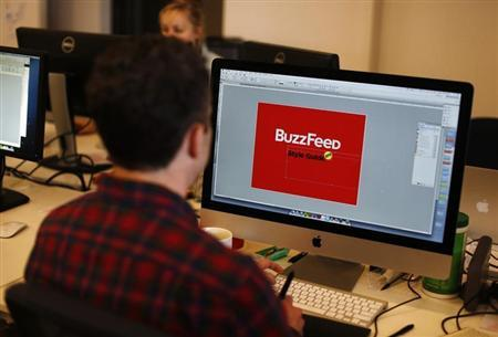 A BuzzFeed employee works on a computer at their office in New York February 19, 2013. REUTERS/Shannon Stapleton