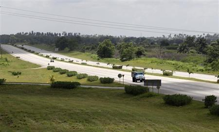 A truck carrying bananas travels on Cuba's main highway on the outskirts of Havana August 8, 2013. REUTERS/Desmond Boylan