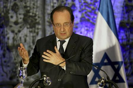 France's President Francois Hollande delivers a statement to the media at the residence of Israel's President Shimon Peres in Jerusalem November 17, 2013. REUTERS/Abir Sultan/Pool