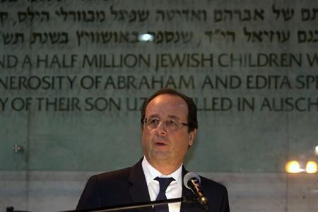 French President Francois Hollande speaks during his visit to the Hall of Remembrance at Yad Vashem Holocaust Memorial museum in Jerusalem November 17, 2013. REUTERS/Menahem Kahana/Pool