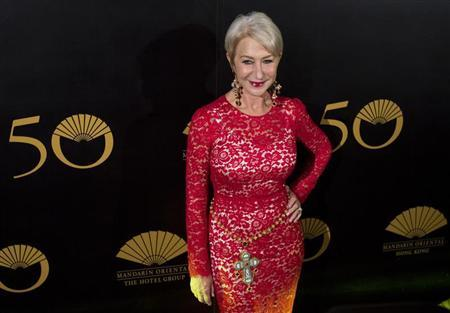 British actress Helen Mirren poses on the red carpet as she arrives at an event celebrating the 50th anniversary of the Mandarin Oriental hotel in Hong Kong October 17, 2013. REUTERS/Tyrone Siu