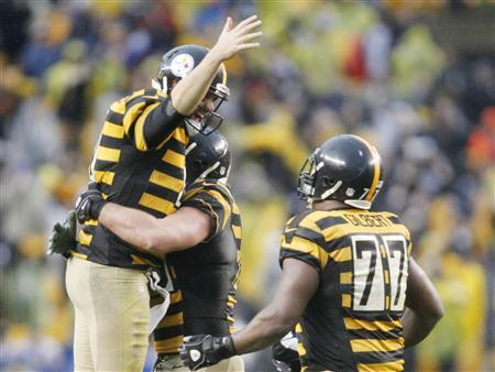 Nov 17, 2013; Pittsburgh, PA, USA; Pittsburgh Steelers quarterback Ben Roethlisberger (left) celebrates a late game touchdown with tackle Marcus Gilbert (77) against the Detroit Lions during the fourth quarter at Heinz Field. The Pittsburgh Steelers won 37-27. Mandatory Credit: Charles LeClaire-USA TODAY Sports