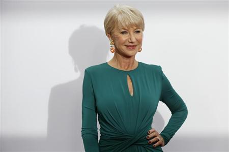 Cast member Helen Mirren poses at the premiere of the film ''Red 2'' in Los Angeles, California July 11, 2013. The movie opens in the U.S. on July 19. REUTERS/Mario Anzuoni