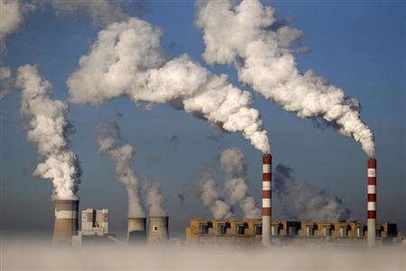 Smoke billows from the chimneys of the Belchatow Power Station, Europe's largest coal-fired power plant, in Belchatow October 31, 2013. REUTERS/Kacper Pempel/Files