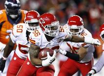 Nov 17, 2013; Denver, CO, USA; Kansas City Chiefs inside linebacker Derrick Johnson (56) returns a fumble in the first quarter against the Denver Broncos at Sports Authority Field at Mile High. Mandatory Credit: Isaiah J. Downing-USA TODAY Sports - RTX15I3W