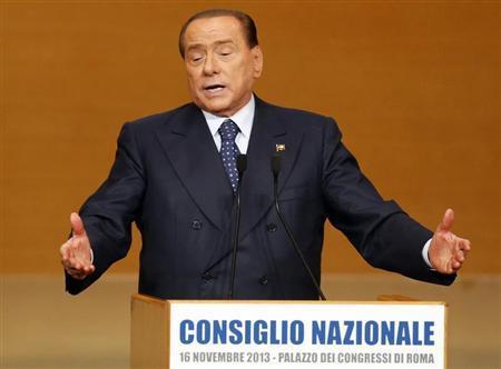 Former Italian prime minister Silvio Berlusconi gestures during a Forza Italia party national congress in Rome November 16, 2013. REUTERS/Stefano Rellandini