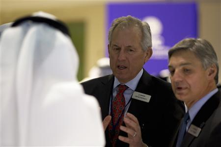 Boeing Chairman James McNerney and Boeing Commercial Airplanes Chief Executive Ray Conner (R) speak with a visitor during the Dubai Airshow November 18, 2013. REUTERS/Caren Firouz