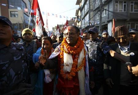 Chairman of the Unified Communist Party of Nepal (Maoist) Pushpa Kamal Dahal, also known as Prachanda, (C) along with his daughter Renu Dahal take part in an election campaign in Kathmandu November 15, 2013. REUTERS/Navesh Chitrakar