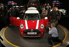Members of the media and guests view the new Mini at BMW's plant in Oxford, southern England November 18, 2013. REUTERS/Suzanne Plunkett