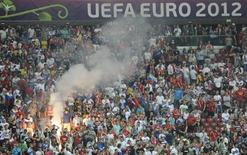 Russia's soccer fans react after defeat at the Group A Euro 2012 soccer match against Greece at National stadium in Warsaw, June 16, 2012. REUTERS/Pawel Ulatowski