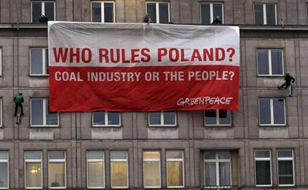 Greenpeace activists place a banner on the Polish Economy Ministry headquarters building during a protest against the World Coal Summit and the 19th conference of the United Nations Framework Convention on Climate Change (COP19), in Warsaw November 18, 2013. REUTERS/Kacper Pempel