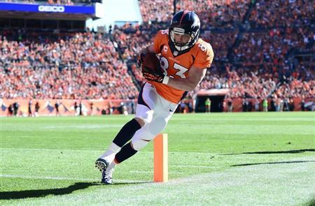 Oct 27, 2013; Denver, CO, USA;Denver Broncos wide receiver Wes Welker (83) scores a touchdown in the first quarter against the Washington Redskins at Sports Authority Field at Mile High. Mandatory Credit: Ron Chenoy-USA TODAY Sports
