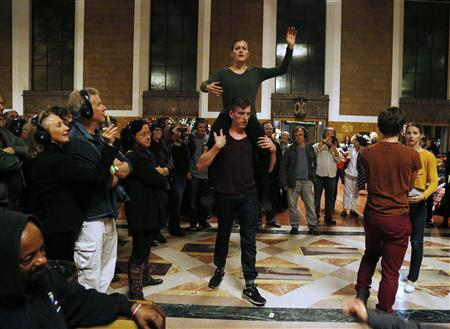 Members of the L.A. Dance Project perform the opera ''Invisible Cities'' at the Amtrak's Union Station in Los Angeles November 15, 2013. REUTERS/Fred Prouser