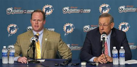 Miami Dolphins General Manager Jeff Ireland (L) speaks next to the team's owner Stephen Ross during a news conference at the team's training facility in Davie, Florida December 12, 2011. REUTERS/Andrew Innerarity