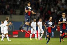Paris Saint-Germain's Edinson Cavani (9) reacts after scoring a goal during his French Ligue 1 soccer match against Ajaccio at Parc des Princes stadium in Paris August 18, 2013. REUTERS/Benoit Tessier