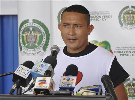Alfredo Usuga alias ''Marlon'', a demobilized member of the Revolutionary Armed Forces of Colombia (FARC), speaks during his release ceremony in Rionegro, Antioquia province, in this May 4, 2013 handout photo by Colombia's Ministry of Defence. REUTERS/Colombia's Ministry of Defence/Handout via Reuters
