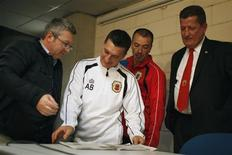 Gibraltar's coach Allen Bulla (2nd L), captain Joseph Chipolina and Gibraltar Football Association President Desmond Reoch (R) speak with a journalist after a news conference at Algarve stadium near Faro November 18, 2013. REUTERS/Rafael Marchante