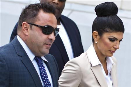 Teresa Giudice, 41, and her husband Giuseppe ''Joe'' Giudice, 43, arrive at the federal court in Newark, New Jersey August 14, 2013. REUTERS/Eduardo Munoz