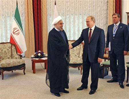 Russia's President Vladimir Putin (2nd L) shakes hands with his Iranian counterpart Hassan Rouhani (L) during a meeting at the Shanghai Cooperation Organization (SCO) summit in Bishkek, September 13, 2013. REUTERS/Mikhail Klimentyev/RIA Novosti/Kremlin