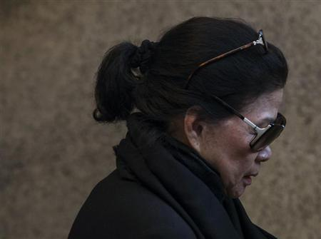 Vilma Bautista, the ex-secretary of former Philippine first lady Imelda Marcos, leaves Manhattan Criminal Court in New York October 21, 2013. REUTERS/Eric Thayer