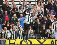 Newcastle United's Shola Ameobi (C) celebrates scoring the winning goal against Wigan Athletic during their English Premier League soccer match at St James Park in Newcastle, northeast England August 19, 2006. REUTERS/David Moir