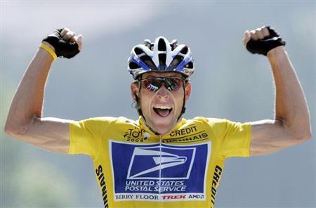 U.S. Postal Service Team rider Lance Armstrong of the United States raises his arms as he crosses the finish line to win the 204.5 km long 17th stage of the Tour de France from Bourd-d'Oisans to Le Grand Bornand, France, July 22, 2004. REUTERS/Wolfgang Rattay