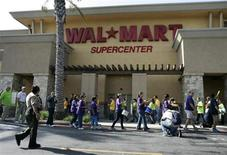 Walmart workers on strike walk a picket line during a protest over unsafe working conditions and poor wages outside a Walmart store in Pico Rivera, California, October 4, 2012. REUTERS/Jonathan Alcorn
