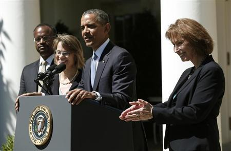 U.S. President Barack Obama speaks from the Rose Garden of the White House to announce his three nominees to fill vacancies on the United States Court of Appeals for the District of Columbia in Washington June 4, 2013. The nominees will be attorney Patricia Ann Millett (R), Georgetown law professor Cornelia Pillard (behind Obama) and U.S. District Court Judge Robert Leon Wilkins (L). REUTERS/Kevin Lamarque
