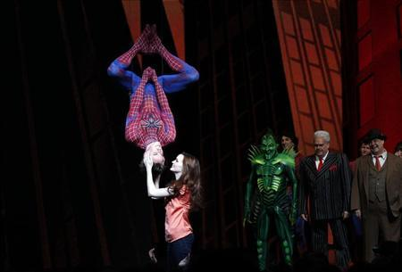Cast member Reeve Carney (L) is kissed by fellow cast member Jennifer Damiano (C) during the curtain call for the Broadway opening of ''Spider-Man: Turn Off The Dark'' in New York June 14, 2011. REUTERS/Jessica Rinaldi