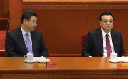 China's President Xi Jinping (L) looks at Premier Li Keqiang as they attend the opening ceremony of the 11th National Women's Congress at the Great Hall of the People in Beijing October 28, 2013. REUTERS/Jason Lee