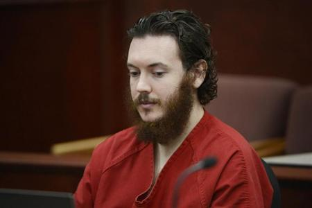 James Holmes sits in court for an advisement hearing at the Arapahoe County Justice Center in Centennial, Colorado June 4, 2013. Holmes, who could face execution if convicted of killing 12 moviegoers last summer, entered a plea of not guilty by reason of insanity on Tuesday, and the judge accepted his plea. REUTERS/Andy Cross/Pool