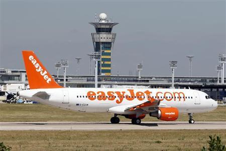 An Airbus A320 EasyJet passenger plane passes by the air traffic control tower as it prepares for take off at Orly Airport, near Paris, August 20, 2013. REUTERS/Charles Platiau