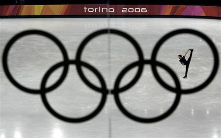 Shawn Sawyer of Canada is seen during a practice session through the Olympic rings at the Palavela figure skating venue ahead of the Torino 2006 Winter Olympic Games in Turin, Italy, February 9, 2006. REUTERS/David Gray