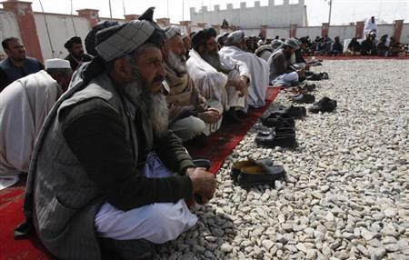 Afghan elders gather during a meeting in Maidan, Wardak province, March 11, 2013. REUTERS/ Mohammad Ishaq