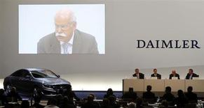 Daimler AG Chief Executive Dieter Zetsche is seen on a screen during the company's annual news conference in Stuttgart February 7, 2013. REUTERS/Michael Dalder