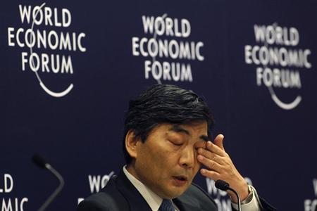 Naoyuki Shinohara, deputy managing director of the International Monetary Fund (IMF), wipes his eye during an interactive session of Rethinking State-led Growth in the World Economic Forum in Jakarta June 13, 2011. REUTERS/Enny Nuraheni