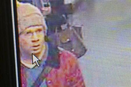 A suspected gunman walking in an underground station in Paris on November 18, 2013, is seen in this handout picture taken from surveillance footage and released by Paris Prefecture de Police on November 19, 2013. REUTERS/Prefecture de Police/Handout via Reuters