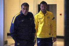 Captain of the Australian soccer team Lucas Neill (R) walks with new team coach Ange Postecoglou to a media conference in Sydney November 18, 2013. REUTERS/David Gray