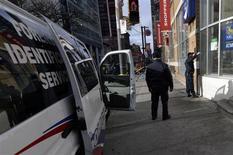 Toronto Police investigate a crime scene in Toronto November 19, 2013. REUTERS/Aaron Harris