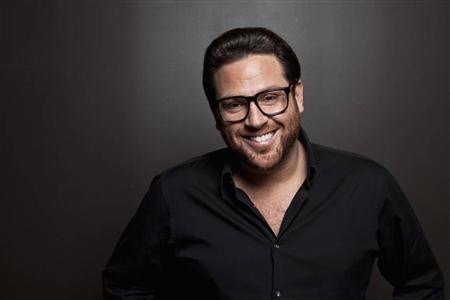 American chef Scott Conant poses inside in his acclaimed Italian restaurant Scarpetta in New York City in an undated handout photo . REUTERS/Brent Herrig/Courtesy of Scott Conant