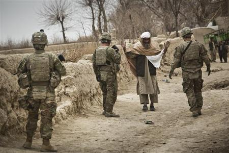 U.S. troops stop a man to search him while on patrol near Command Outpost AJK (short for Azim-Jan-Kariz, a nearby village) in Maiwand District, Kandahar Province, Afghanistan, February 1, 2013. REUTERS/Andrew Burton