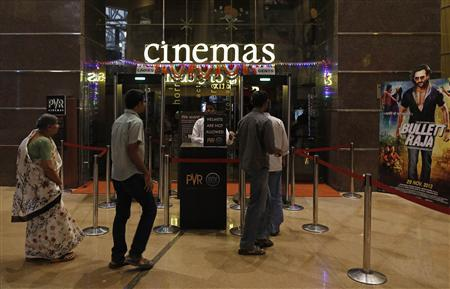Cinema-goers queue for a security check at a PVR Multiplex in Mumbai November 10, 2013. REUTERS/Danish Siddiqui