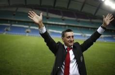 Gibraltar's coach Allen Bula greets supporters after his team's international friendly soccer match against Slovakia at Algarve stadium near Faro November 19, 2013. REUTERS/Rafael Marchante