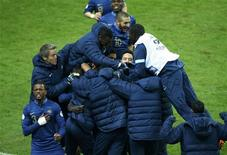 France's soccer team players celebrate after Ukraine's Oleg Guslev (unseen) scored an own goal during their 2014 World Cup qualifying second leg playoff soccer match against Ukraine at the Stade de France in Saint-Denis near Paris November 19, 2013. REUTERS/Gonzalo Fuentes
