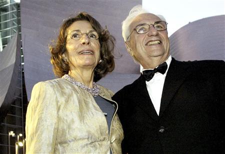 Frank Gehry, who designed the Walt Disney Concert Hall, arrives for the opening night of the $274 million music facility with Diane Disney Miller, daughter of Walt Disney, in Los Angeles in this file photo from October 23, 2003. REUTERS/Robert Galbraith/Files