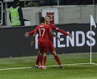 Portugal's Cristiano Ronaldo celebrates his goal against Sweden, with teammate Nani, during the second leg of their 2014 World Cup qualifying soccer match against Portugal at Friends Arena in Stockholm November 19, 2013. REUTERS/Pontus Lundahl/TT News Agency