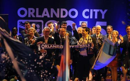 MLS Orlando City SC team president Phil Rawlins (left), MLS commissioner Don Garber, (center) and Orlando City SC Owner Flavio Augusto Da Silva (right) as Major League Soccer official announces a expansion franchise agreement with Orlando City Soccer at Cheyenne Saloon. David Manning-USA TODAY Sports