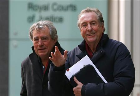 Monty Python members Eric Idle (R) and Terry Jones leave the High Court during a lunch break in central London December 4, 2012. Three members of Monty Python are being sued by one of the producers of their film ''Monty Python and the Holy Grail''. The Pythons are at odds with Mark Forstater, the producer of the ''Holy Grail'', who says he has not received his fair share of profits from ''Spamalot'', a spin-off musical. REUTERS/Andrew Winning