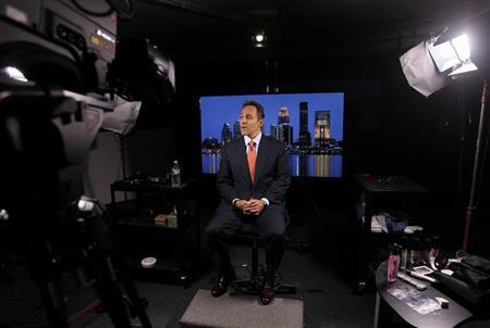 Republican senate candidate Matt Bevin prepares for an interview with a Fox reporter in Louisville, Kentucky, October 23, 2013. REUTERS/John Sommers II